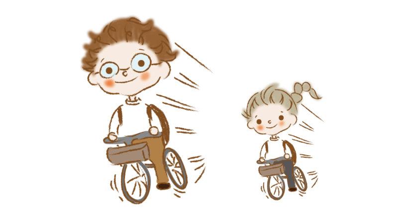 自転車を漕ぐママとパパ
